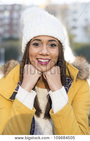 Portrait Of Smiling Beautiful Latin Woman With Winter Clothing.