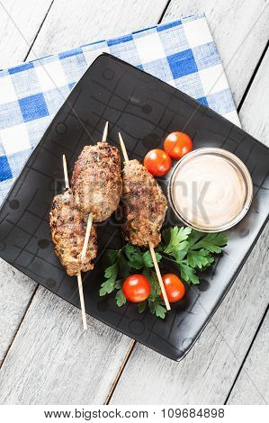 Barbecued Kofta With Vegetables On A Plate
