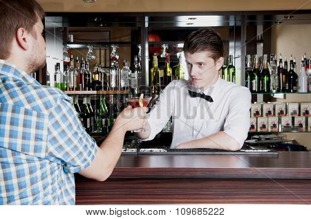 Bartender Gives The Man Ordered A Cocktail