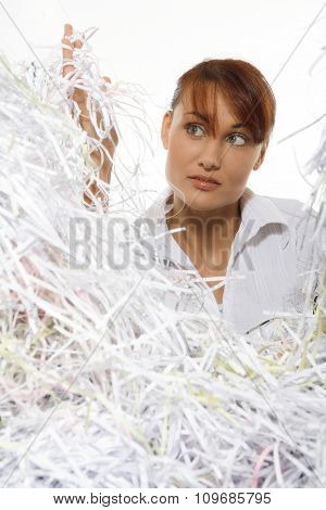 Young woman with shredded pape