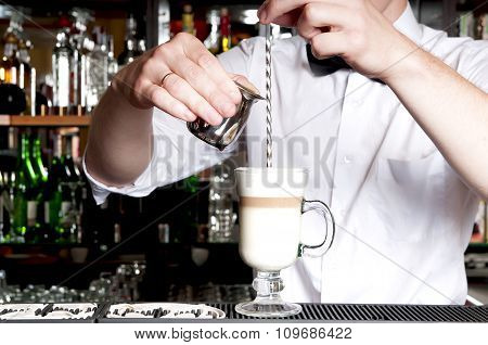 Young Handsome Barista Making Latte Behind The Bar In Cafe.