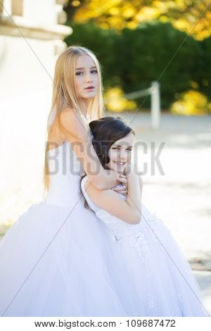 Teenage With Girl In White Dresses