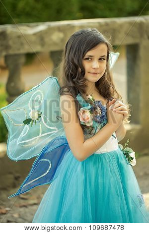 Beautiful Girl In Dress With Wings