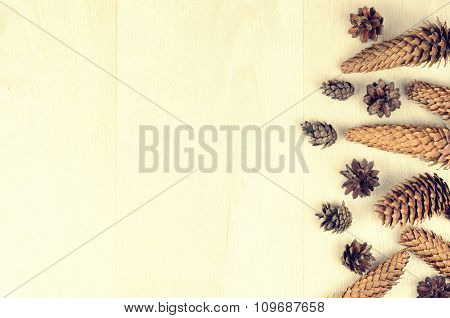 Fir Cones On A Wooden Background