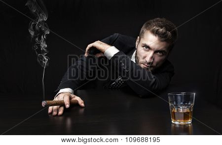 Businessman with drink and cigarette