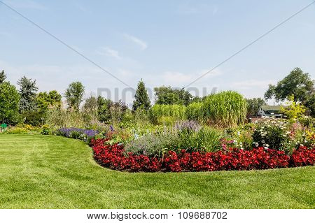 Manicured Lawn And Lush Garden