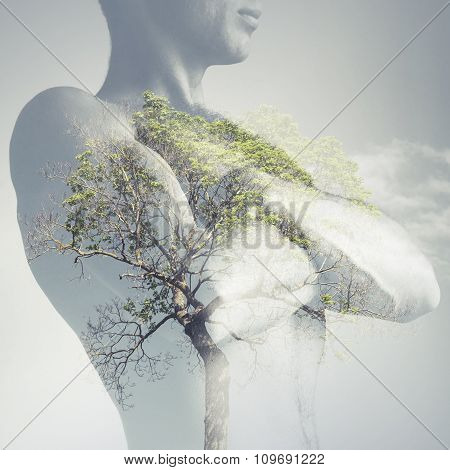 Strong Sporty Young Man Torso Combined With Green Tree