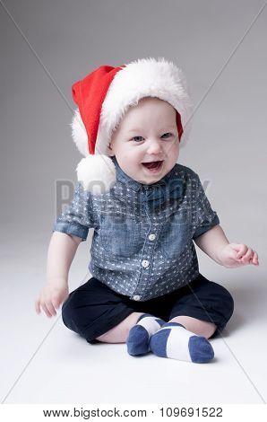 Laughing Baby Boy In Santa Hat.