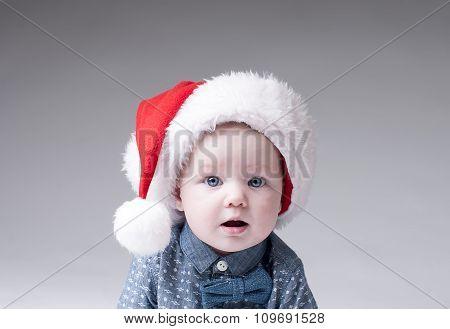 Portrait baby boy in santa hat