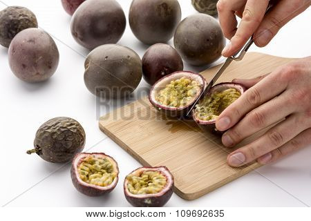 Halving Passion Fruits With A Kitchen Knife