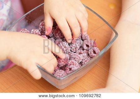 Baby Hands Taking Frozen Raspberries