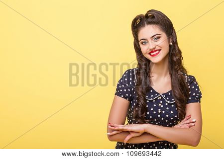 Cheerful slim girl is expressing positive emotions