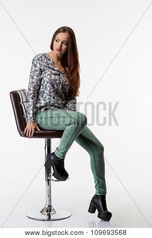Young ukrainian girl sitting on the fashion chair