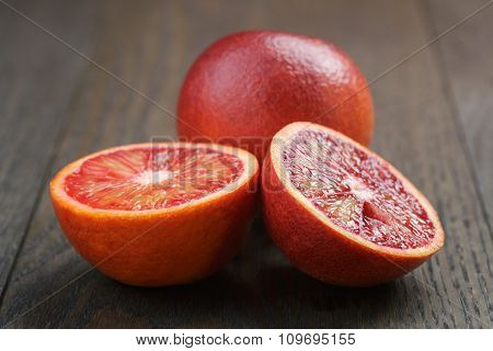 red sicilian oranges sliced on wooden table