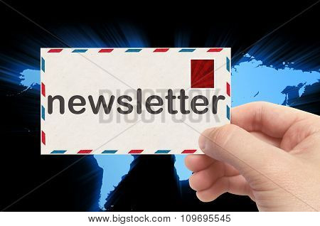 Hand Holding Envelope With Newsletter Word And World Background