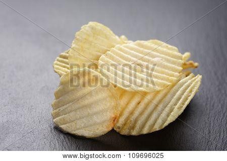salted potato ships on old slate board