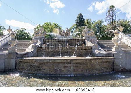 A fountain near a castle.