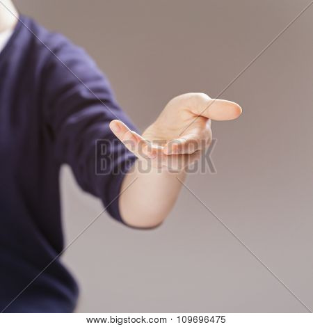 female teen hand to presenting or showing something selective focus