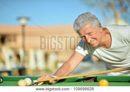 Mature man Playing billiard