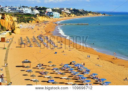 People enjoying the sun on Albufeira Beach