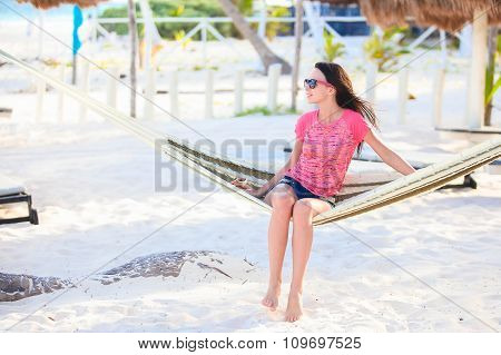 Young woman enjoying a sunny day in the hammock