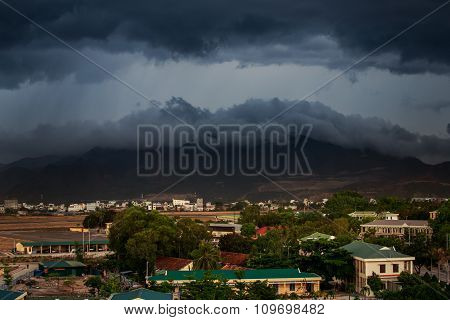 Upper View Of City Dark Thunderclouds Above City Mountains