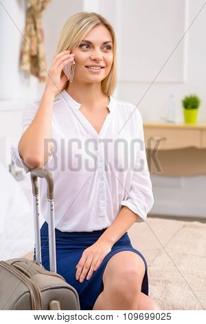 Young woman talking on the phone.