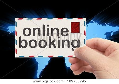 Hand Holding Envelope With Online Booking Word And World Background