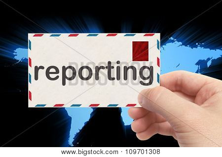 Hand Holding Envelope With Reporting Word And World Background
