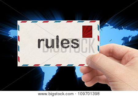 Hand Holding Envelope With Rules Word And World Background
