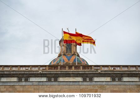 Close Up of Decorative Dome and Flags of Spain and Barcelona Flying on Roof of Palau de la Generalitat de Catalunya, a Medieval Building Housing Government Offices in Barcelona, Spain