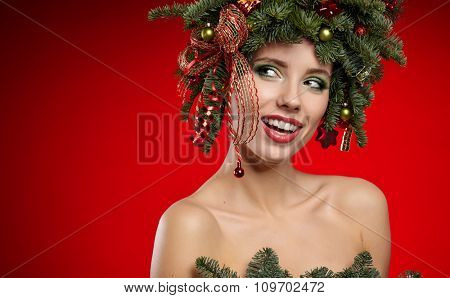 Christmas fashion model woman. Xmas New Year hairstyle and make up. Beauty Girl portrait.