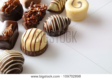 Assorted Bonbons On A White Table Top Diagonal Aligned