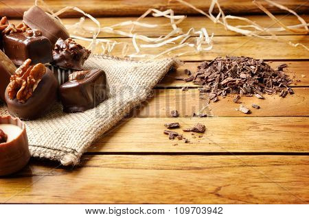 Bonbons Stacked On Burlap Sack On Wood Table