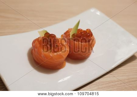Salmon Ikura (salmon Eggs And Avocado Wrapped With Raw Salmon)