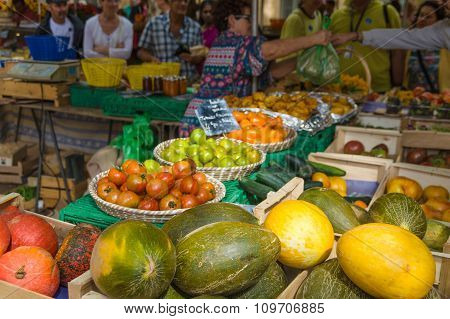 Selling Vegetable On Market Place In Provence, France.