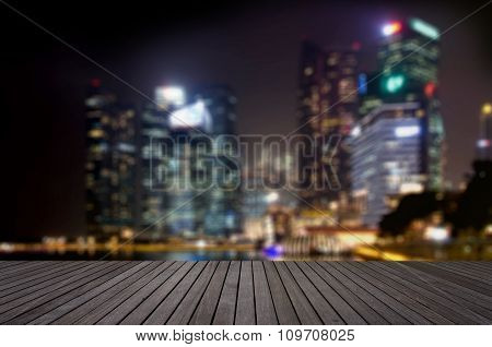 Wood floor in dark grey color tone with blurred abstract background of Singapore night lights city v