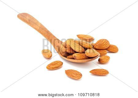 Almond Seed In Wooden Spoon Isolated On White Background