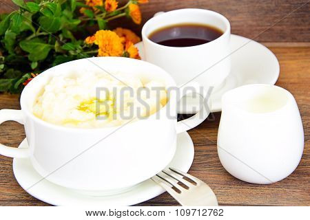 Rice Porridge with Sweet Butter, Jam and Coffee