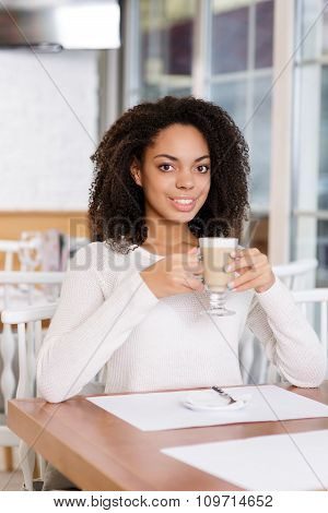 Restaurant guest is drinking coffee.