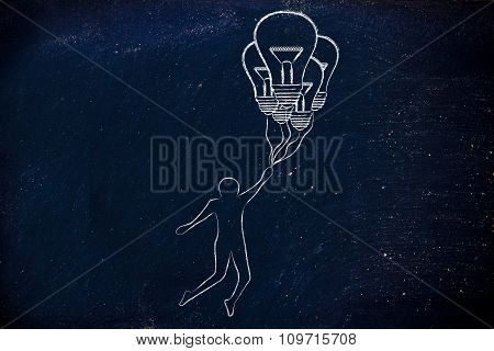 Person Holding Up To Lightbulb Shaped Balloons
