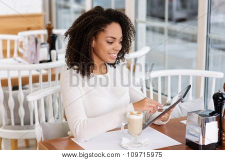 Restaurant customer using portable tablet.