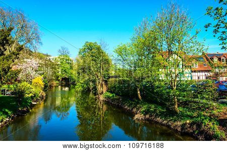 Spring on the banks of Kinzig River in Gelnhausen, the Kaiserpfalz, Hesse, Germany