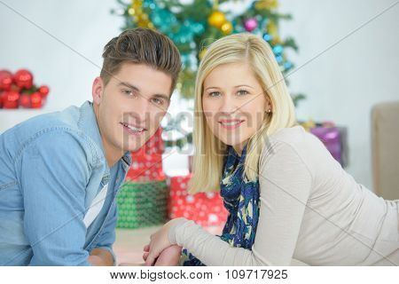 Portrait of couple in front of christmas tree