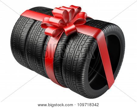 Gift Set Four Tyres With A Wrapped Red Ribbon And Bow.