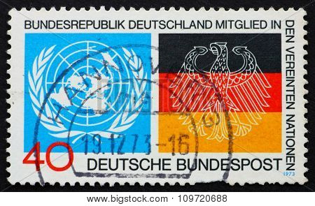 GERMANY - CIRCA 1973: a stamp printed in the Germany shows Emblems from UN and German Flags Germanys admission to the UN, circa 1973