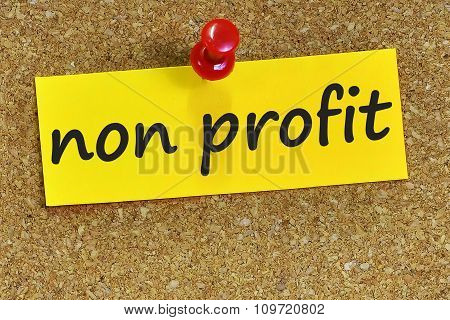 Non Profit Word On Yellow Notepaper With Cork Background