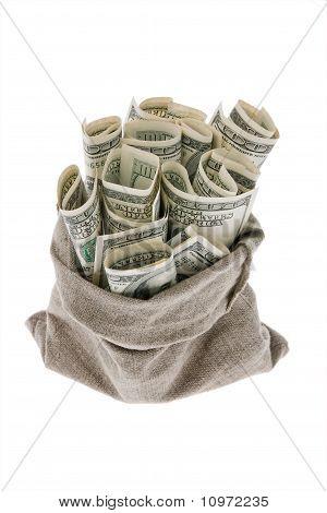 Dollar money bills into a bag