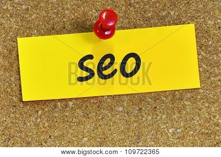 Seo Word On Yellow Notepaper With Cork Background
