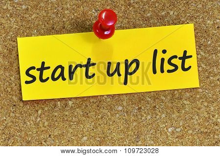 Start Up List Word On Yellow Notepaper With Cork Background